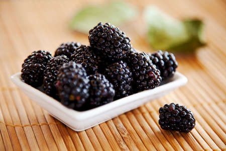 blackberries isolated on a bamboo mat background