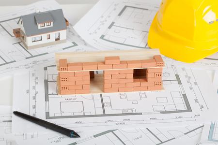 Photo pour Model house construction with brick on blueprint - image libre de droit