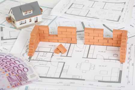 Photo for Model house construction with brick on blueprint and five hundred euro banknote - Royalty Free Image