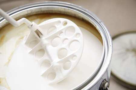 A stirrer used to mix the oil based warm white paint.
