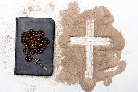 Photo for Old Bible, rosary and Cross of ash on white - Royalty Free Image