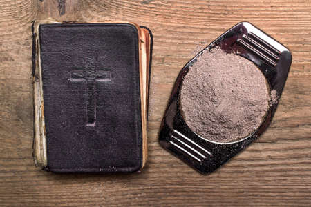 Photo for Old Bible, Cross and ash on wooden - Royalty Free Image