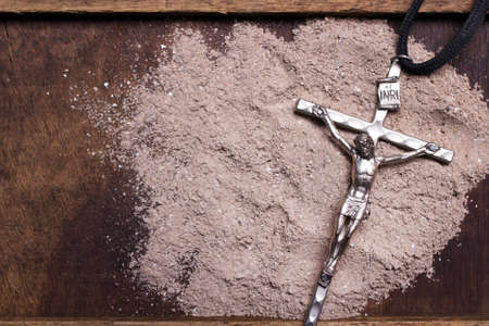 Photo for Cross and ash - symbol of Ash Wednesday. Copy space - Royalty Free Image