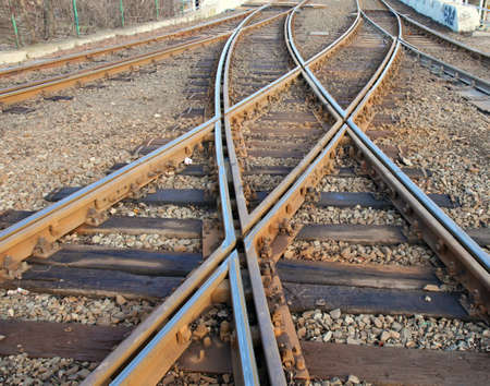 Closeup photo about interwaved rails.