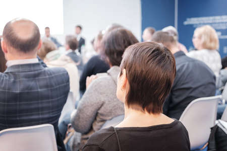 Foto de Business woman and people Listening on The Conference. Horizontal Image - Imagen libre de derechos