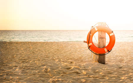 Photo for Life preserver on sandy beach somewhere in Mexico - Royalty Free Image