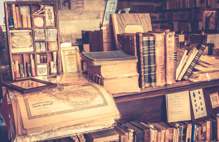 MONTEPULCIANO, ITALY - JUNE 23, 2015: collection of antique books and maps in tuscan antiquarian bookshop in Montepulciano town, Italy