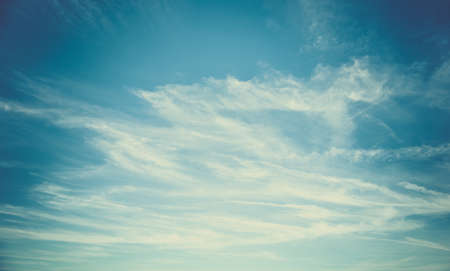 Blue sky and white fluffy clouds background