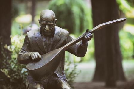 Statue of Asik Veysel (Satiroglu), a Turkish minstrel and poet of the Turkish folk literature at Gulhane Park, Istanbul, Turkey.
