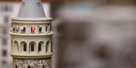 Foto de Miniature Galata Tower With Small Sightseeing Tourist Figures - Imagen libre de derechos