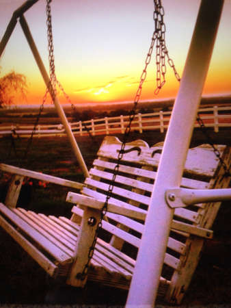 Lonesome swing watches as day slowly turns to night