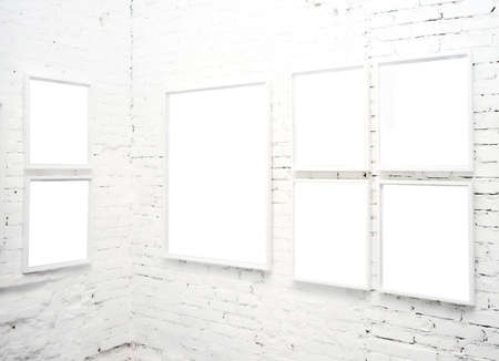 brick wall in museum with empty frames