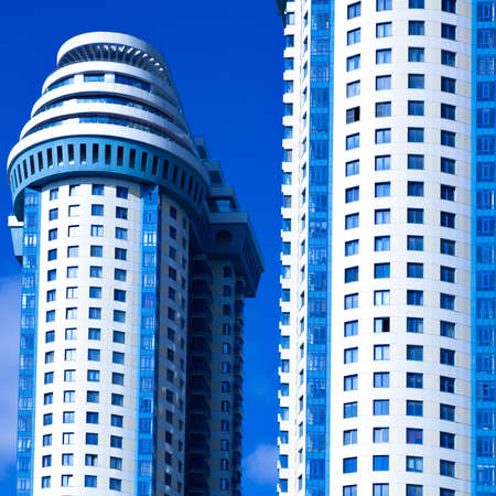 Blue skyscrapers towers with balconys, square composition