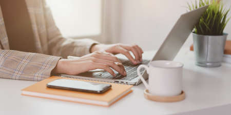 Photo for Close-up view of businesswoman typing on laptop computer while working in the modern office - Royalty Free Image