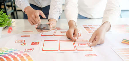 Photo for Cropped shot of young professional UX graphic designer team developing the smartphone templates in office room - Royalty Free Image