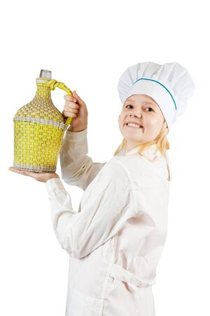 Portrait of smiling female cook holding large bottle over white