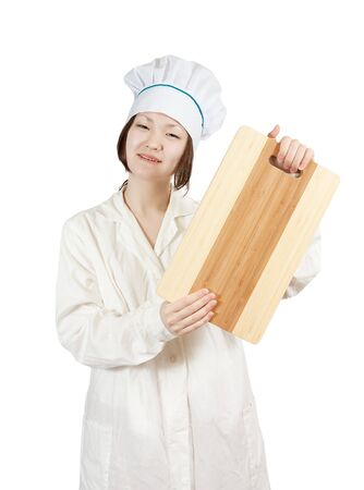 cook asian woman in toque with cutting board over  white  background