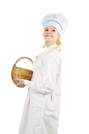 cook woman in toque with wicker basket  over  white  background