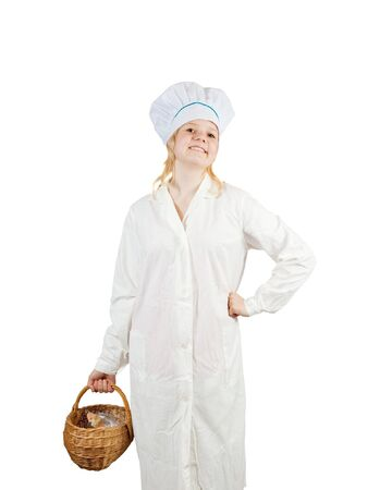 Young cook girl  holding  wicker basket  isolated over white