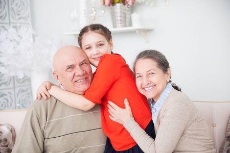 Photo pour Teen girl with her grandparents. - image libre de droit