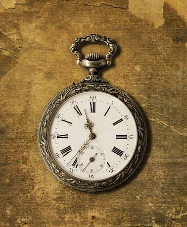 Old Pocket watch from the 1900s on a textured background