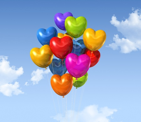 colored heart shape balloons floating on a blue sky