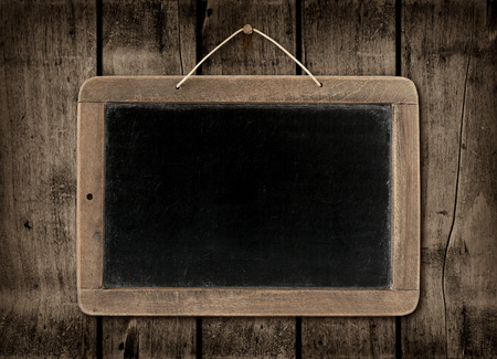 Blackboard on a old dark wood wall background texture