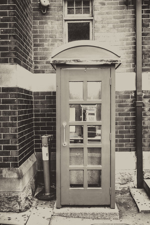 Vintage UK red phone booth, black and white picture