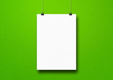 Photo for White poster hanging on a green wall with clips. Blank mockup template - Royalty Free Image