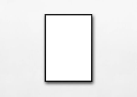 Photo for Black picture frame hanging on a white wall. Blank mockup template - Royalty Free Image