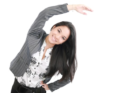 business woman portrait stretching isolated over a white background