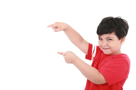 A little boy points at something, boy presents something