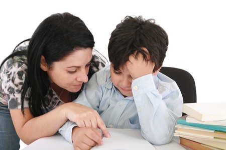 mother helping with homework to her son indoor