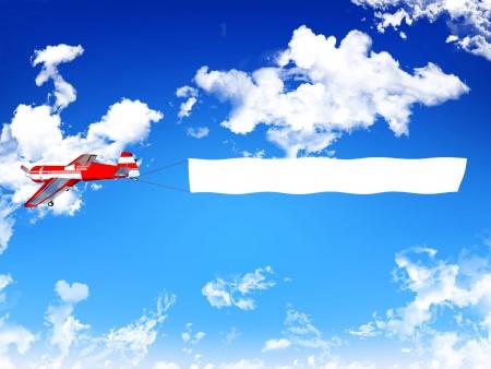 Photo pour Biplane aircraft pulling advertisement banner  - image libre de droit