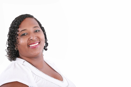 close up of plus size black model smiling, copyspace on white