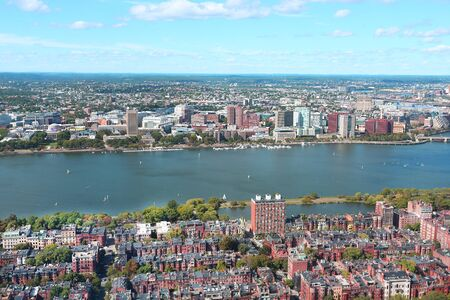 Aerial view of Boston skyline and Cambridge district separated by Charles River.