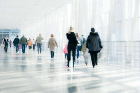 People walking in modern downtown. Blurred motion.