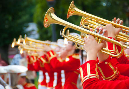 Girl Brass Band in red uniform performing