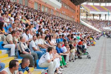 SUMY, UKRAINE - JUNE 28: The audience in the stands at a football match 28, 2010 in Sumy, Ukraine