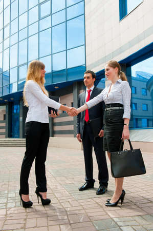 Business people shaking hands in a modern downtown