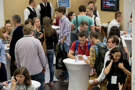 Photo pour Moscow, Russia - September 2, 2016: People have coffee break during Digital Marketing Conference at Russia Today information agency hall - image libre de droit