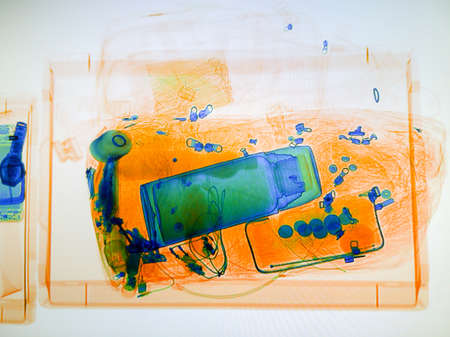 Photo pour Scanned baggage on the x-ray scanner screen in the airport - image libre de droit