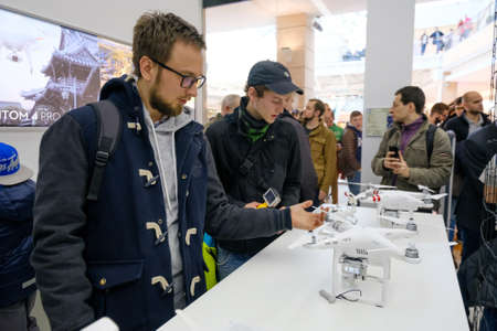 Moscow, Russia - April 1, 2017: Customers watch quadrocopters at the opening of DJI Authorized Store