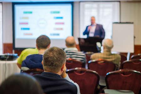 Foto de Audience listens lecturer at workshop in conference hall, rear view - Imagen libre de derechos