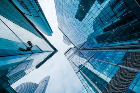 Foto de Skyscrapers in downtown area, bottom view, blue tones - Imagen libre de derechos