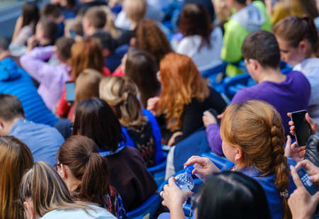 Photo pour Business conference attendees sit and listen to lecturer, rear view - image libre de droit