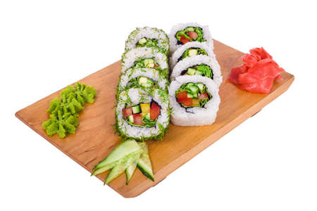 A composition of vegetable sushi on a wooden board