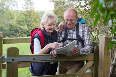 Photo pour Active Senior Couple On Walk In Countryside - image libre de droit