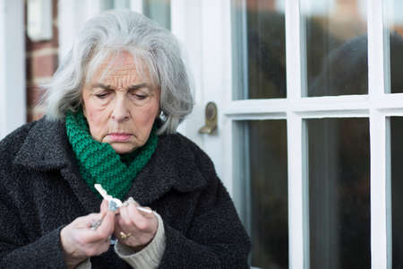 Photo for Confused Senior Woman Trying To Find Door Key - Royalty Free Image