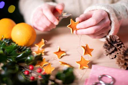 Foto für Close Up Of Woman Making Eco Friendly Eco Christmas Decorations From Orange Peel - Lizenzfreies Bild